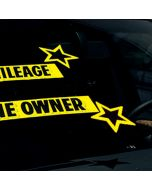 Yellow and Black die cut Vinyl Star decal stickers on vehicle windshield at auto dealer