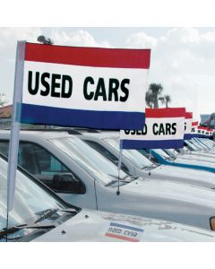 Red White Blue Stripe Used Cars Antenna Pennants on vehicles at auto dealership