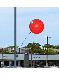 Premium Reusable Balloon Light Pole Kit: Single Balloon on a pole over an auto dealership