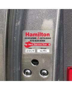 Customer Service Reminders on Roll with Adhesive inside car door in service department of an auto dealership