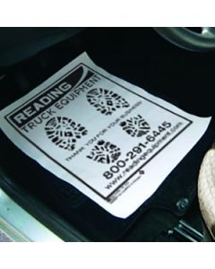 One Color Custom Floor Mat on the floor in a vehicle in the service department of an auto dealership