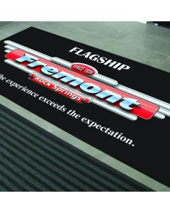 4' x 6' Digiprint Rubber Floor Mat in the foyer of an auto dealership