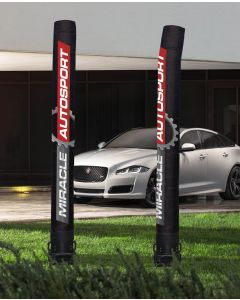 Custom 18' Digital Message Tubes on the grass in front an auto dealership