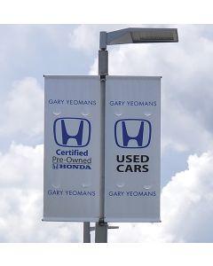 Custom Vinyl Drape Flags on poles above auto dealership
