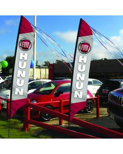 Custom Feather Flags on poles in front of auto dealership