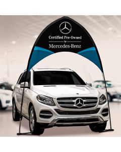 Custom Arch Banner Kit over a vehicle at an auto dealership