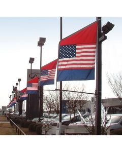 Double Sided Motion Bracket Flag on poles at an auto dealership
