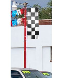 Checkered Flags 3x8 on a pole at an auto dealer lot