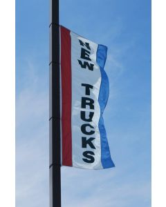 Single-Sided Message Flag without Sleeves on pole over an auto dealership