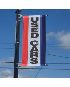 Single-Sided Message Drape Flag with Sleeves on pole over an auto dealership