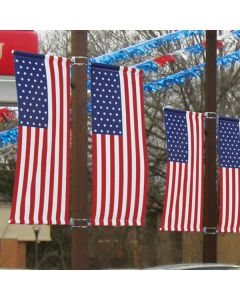 3' X 8' Vertical American Flag with Sleeves on pole at an auto dealer lot