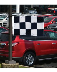 Checkered Flag 3x5 on a pole in front of vehicles in an auto dealership