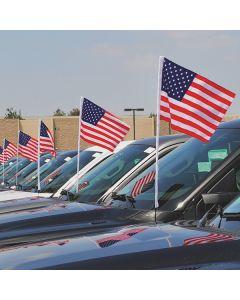 U.S. Flag Antenna Pennants on vehicles antennas in an auto dealer lot