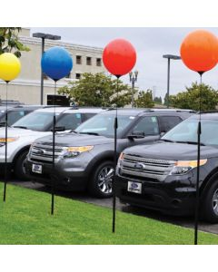 Premium Reusable Balloon Ground Pole Kit on poles in front of an auto dealership