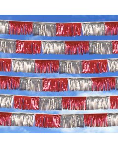 Metallic Streamer: red silver in sky over an auto dealership