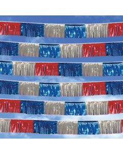 Metallic Streamer: red silver blue in sky over auto dealership