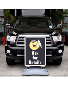 Outdoor Message Sign Kit in front of a vehicle in an auto dealership