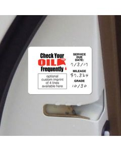 Econo Oil Change Reminder Stickers inside car door in service department of an auto dealership