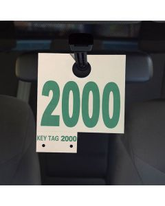 Numbered Service Tags hanging on vehicle rear view mirror in service department of an auto dealership