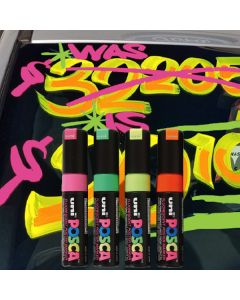 Small POSCA Markers on vehicle windshield at an auto dealer lot