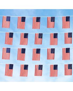 Patriotic US Flag Strings above vehicles at an auto dealer