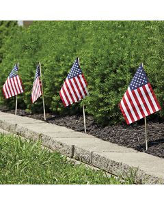 American Stick Flags in a row in front of an auto dealership