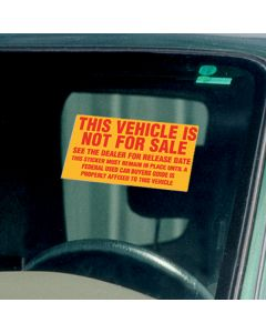 Not For Sale Sticker red on yellow on vehicle window at auto dealership